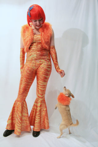 Our model is wearing the Fur Bolero Vest in Orange.