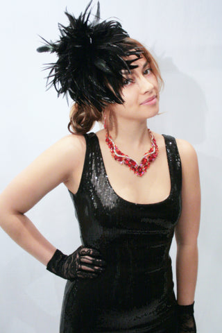 Our model is wearing the Fierce Rooster Feather Hairclip in Black Saddles Hackle.