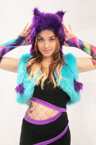 Our model is wearing the Faux Fur Kitty Hat in Purple.
