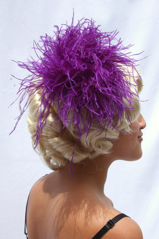 Our model is wearing the Ostrich Feather Hairclip in Purple.