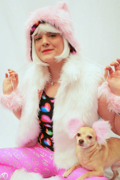 Our model is wearing the Faux Fur Kitty Hat in Light Pink.
