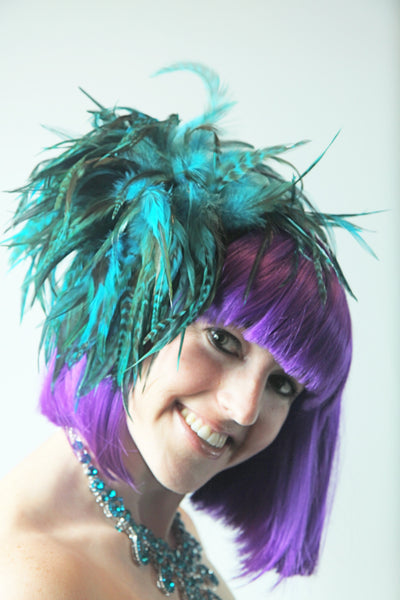 Our model is wearing the Fierce Rooster Hairclip in Turquoise Saddle Hackle.