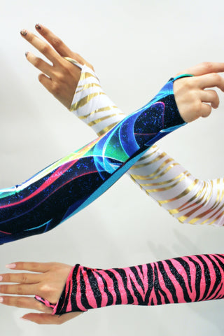 Our models are wearing the Gauntlet Gloves in Gold Zebra, Blue Swirl and Velvet Pink Zebra.