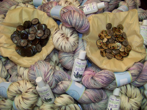 Yarn, buttons and lotion for knitters