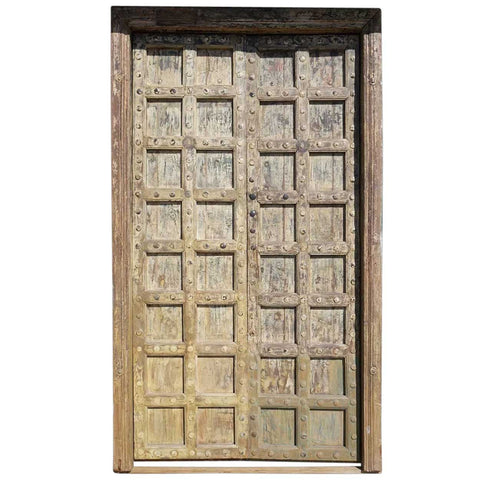 Large Indian Yellow Painted Teak and Iron Mounted (Clavos) Double Door and Jamb