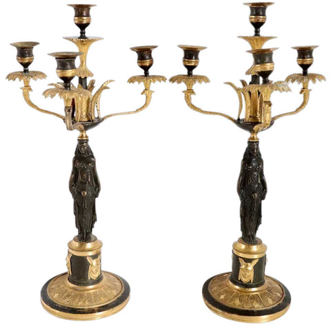 Pair of French Empire Fire Gilt and Patinated Bronze Four-Light Figural Candelabra