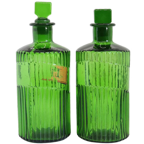 Pair of English Victorian Glass Emerald Green Fluted Apothecary Chemist Poison Bottles