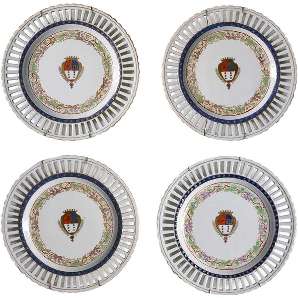 Set of Four Porcelain Plates with Coat of Arms