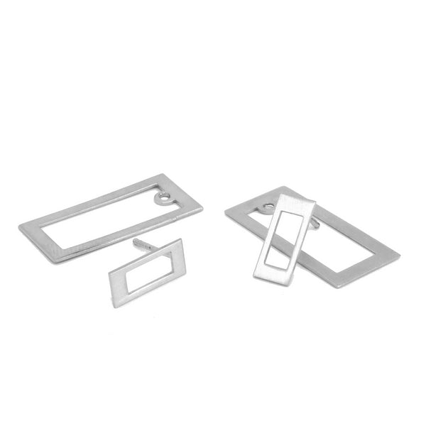 TRIS TRAS SILVER RECTANGLE DRAWN EARRINGS. PLATONICA. MINIMAL COLLECTION. CONTEMPORARY JEWELRY. MINIMALIST JEWELRY. AUTHOR JEWELRY. MADE IN GRANADA. MADE IN ANDALUSIA. MADE IN SPAIN. CRAFTS. HAND-MADE JEWELRY