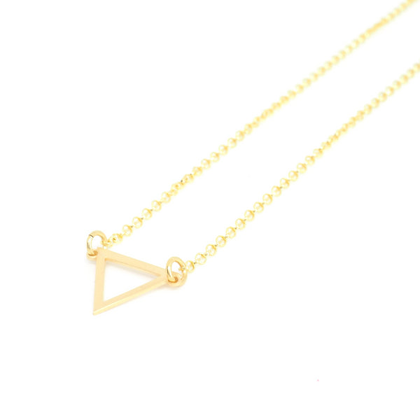 Openwork triangle pendant from the Minimal collection by PLATÓNICA. Gold plated silver. Minimalist jewelry. Contemporary jewelry. Author jewelry. Made in Granada, Andalusia, Spain. Jewelry workshop in the Albaicín. Crafts. Hand-made jewelry. Jewels made from Andalusia. Geometry. Simple and elegant style.