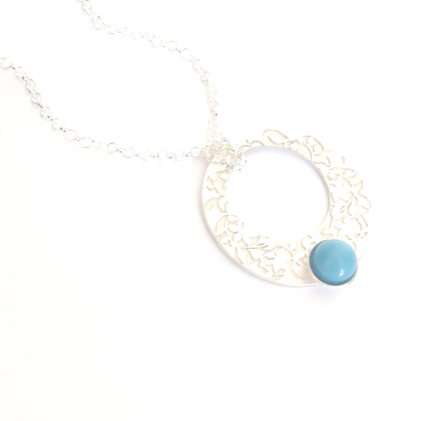 Blue Nasrid Palaces detail pendant inspired by the wall decoration of the Alhambra, Granada. Signature jewelry based on the ataurique plasterwork of Andalusian architecture. Contemporary sterling silver and glass jewelry. Ethnic and sophisticated style. Made in Spain. Local crafts.