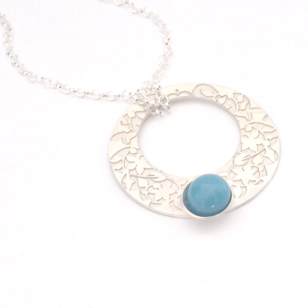 Blue Nasrid Palaces detail pendant inspired by the mural decoration of the Alhambra, Granada. Signature jewelery based on the ataurique plasterwork of Andalusian architecture. Contemporary sterling silver and glass jewelry. Ethnic and sophisticated style. Made in Spain. Local crafts.