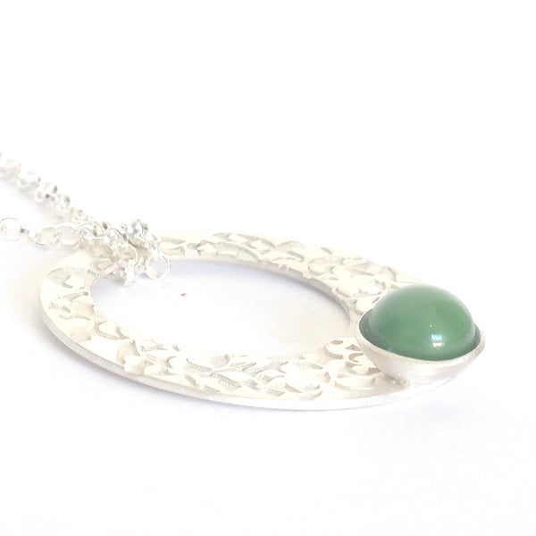 Green Nasrid Palaces detail pendant inspired by the mural decoration of the Alhambra, Granada. Signature jewelery based on the ataurique plasterwork of Andalusian architecture. Contemporary sterling silver and glass jewelry. Ethnic and sophisticated style. Made in Spain. Local crafts.