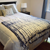 Shibory Cotton Throw Blanket Blue on a bed