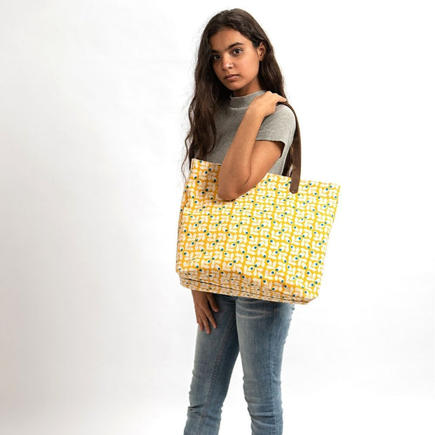 Canvas Tote - Yellow Print with Blue Berries model