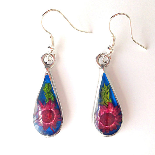 Teardrop-shaped alpaca silver earrings with red flower in clear resin