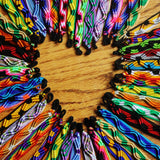 Colorful friendship bracelets made with acrylic yarn