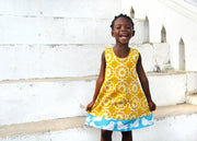 Global Mamas Girls 100% Organic Cotton Reversible Dress - Chroma Mustard model