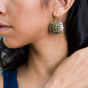 Arabesque Brass Earrings on model