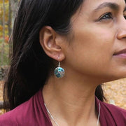 Saja Round Abalone and Sterling Silver Scroll Earrings from Bali Indonesia model