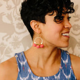 Dangling Pom Earrings Orange on model by Mata Traders