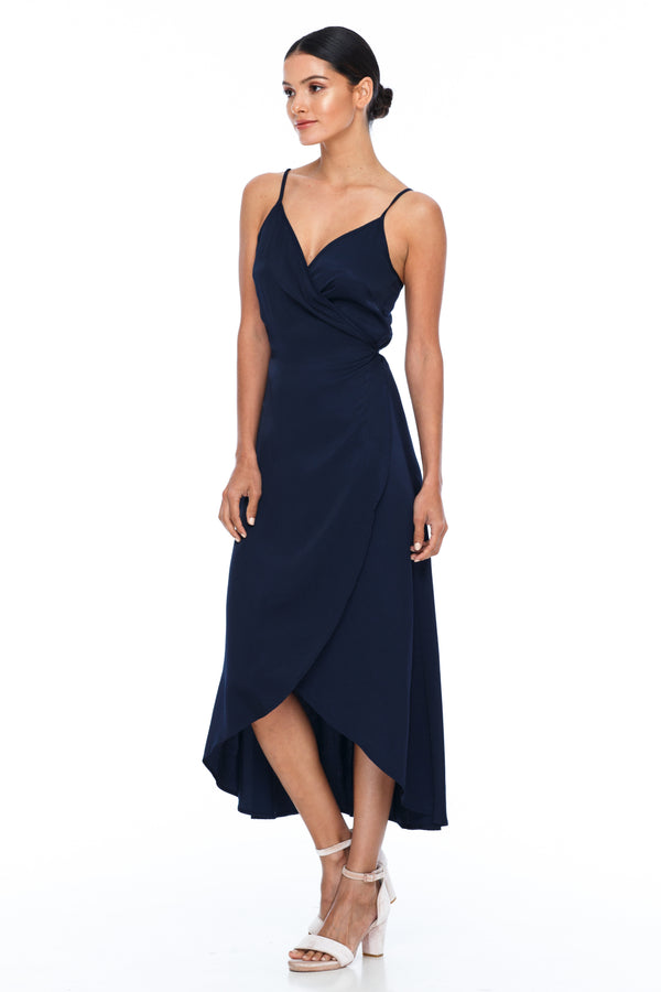 The Adore Dress is part of the BLAK BRIDESMAIDS - Made to Order Collection.  A beautiful wrap bridesmaid dress with a scooped hemline which gives a soft feminine touch.  A deep V neckline and strap detailing at the back.  Being a wrap dress this is an easy option for overseas bridesmaids  Dainty adjustable back strap/tie. Wrap Ankle length back, midi length front