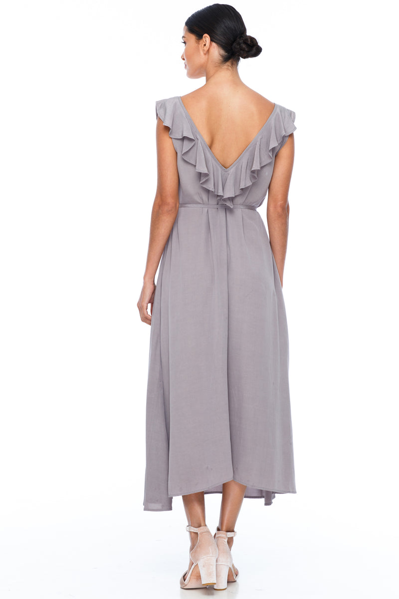 BLAK BRIDESMAIDS - Be Mine Dress - Pewter - Low V neck with ruffle frill neckline front and back. Midi length. Also comes self belt waist tie. Soft Viscose fabric. Image shows back View.