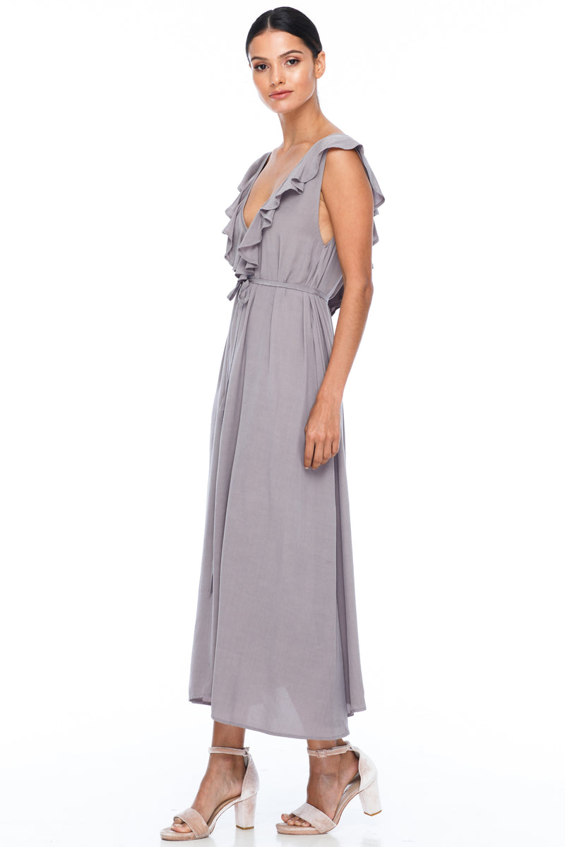 BLAK BRIDESMAIDS - Be Mine Dress - Pewter - Low V neck with ruffle frill neckline front and back. Midi length. Also comes self belt waist tie. Soft Viscose fabric. Image shows side View.