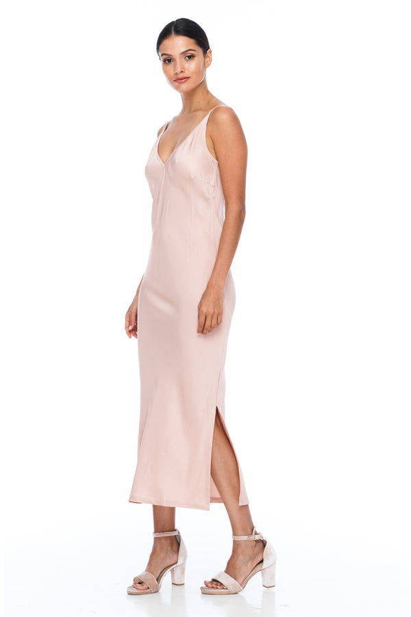 The Cairo Dress is part of the BLAK BRIDESMAIDS - Made to Order Collection.  Featuring a low v neckline and adjustable thin straps with tie detail in back. A classy chic fitted dress cut on the bias for a slinky fit.  - Midi Length  - Side Splits - Rose - Front View
