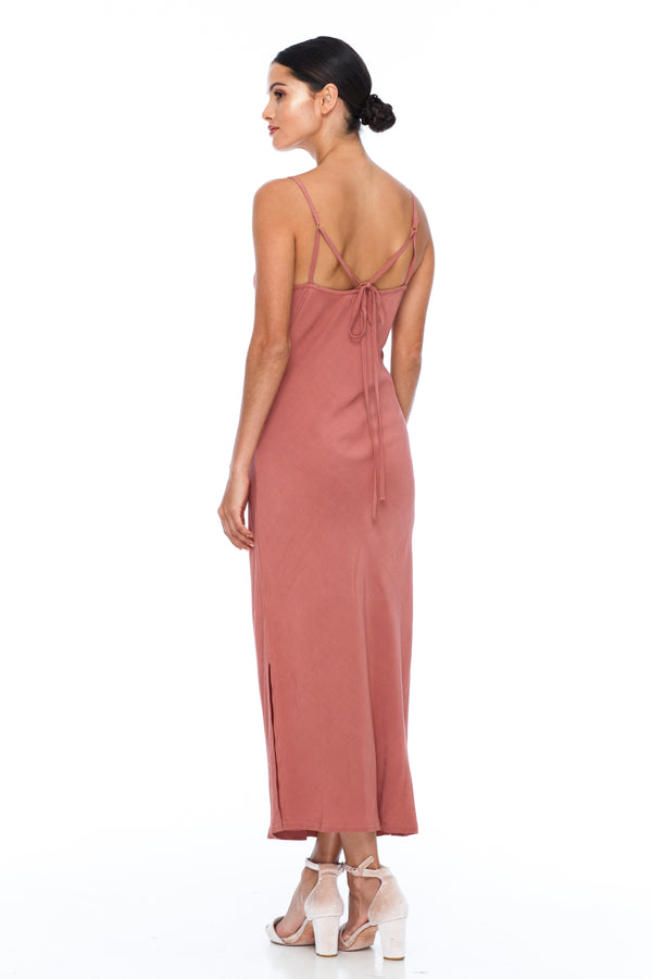 The Cairo Dress is part of the BLAK BRIDESMAIDS - Made to Order Collection.  Featuring a low v neckline and adjustable thin straps with tie detail in back. A classy chic fitted dress cut on the bias for a slinky fit.  - Midi Length  - Side Splits - Becca Pink - Back View