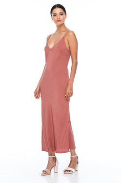 The Cairo Dress is part of the BLAK BRIDESMAIDS - Made to Order Collection.  Featuring a low v neckline and adjustable thin straps with tie detail in back. A classy chic fitted dress cut on the bias for a slinky fit.  - Midi Length  - Side Splits - Becca Pink - Front View