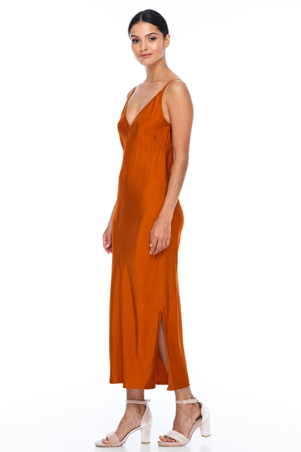 BLAK BRIDESMAIDS -  Cairo Dress - Siesta - Featuring a low v neckline and adjustable thin straps with tie detail in back. A classy chic fitted dress cut on the bias for a slinky fit.  Midi Length / Side Splits / 100% viscose. Image Showing Side View