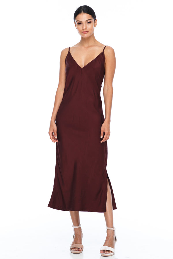 BLAK BRIDESMAIDS -  Cairo Dress - Cinnamon - Featuring a low v neckline and adjustable thin straps with tie detail in back. A classy chic fitted dress cut on the bias for a slinky fit.  Midi Length / Side Splits / 100% viscose. Image shows front view