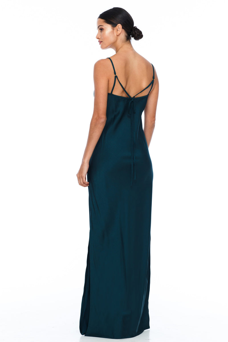 BLAK BRIDESMAIDS  The Long Cairo dress is classic and simple - cut on a bias it hugs the body and falls beautifully. The style has a deeper V neckline than our other styles, yet has adjustable straps which means the dress is able to sit higher if wanted.   This is a made to order BLAK Bridesmaids style - Emerald - Back view