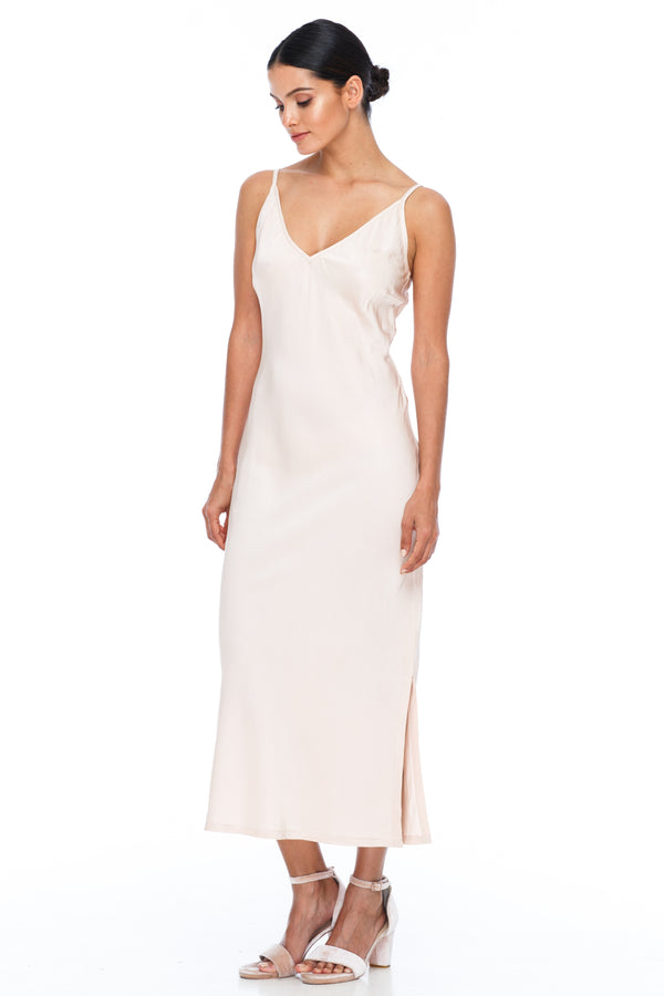 BLAK BRIDESMAIDS -  Cairo Dress - Alyssa Nude - Featuring a low v neckline and adjustable thin straps with tie detail in back. A classy chic fitted dress cut on the bias for a slinky fit.  Midi Length / Side Splits / 100% viscose. Image shows front view