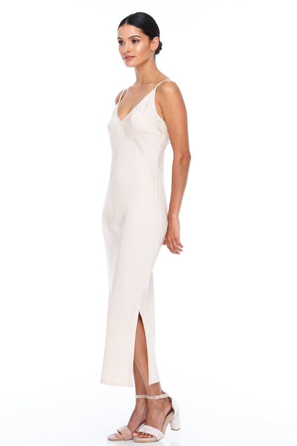 BLAK BRIDESMAIDS -  Cairo Dress - Alyssa Nude - Featuring a low v neckline and adjustable thin straps with tie detail in back. A classy chic fitted dress cut on the bias for a slinky fit.  Midi Length / Side Splits / 100% viscose. Image shows side view