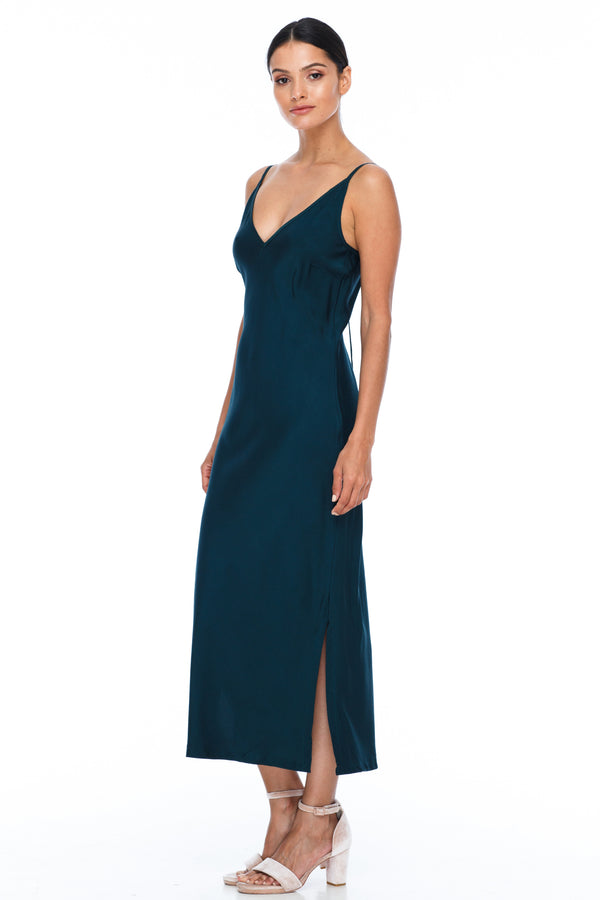 BLAK BRIDESMAIDS -  Cairo Dress - Emerald - Featuring a low v neckline and adjustable thin straps with tie detail in back. A classy chic fitted dress cut on the bias for a slinky fit.  Midi Length / Side Splits / 100% viscose.