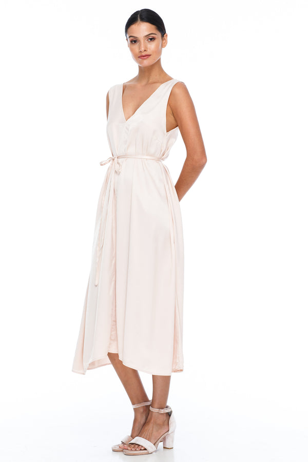 BLAK BRIDESMAIDS -  Calm Dress - Alyssa Nude - Featuring a low v-neckline front and back with wider straps. An easy fit dress with self-waist tie.  Midi Length / 100% viscose.