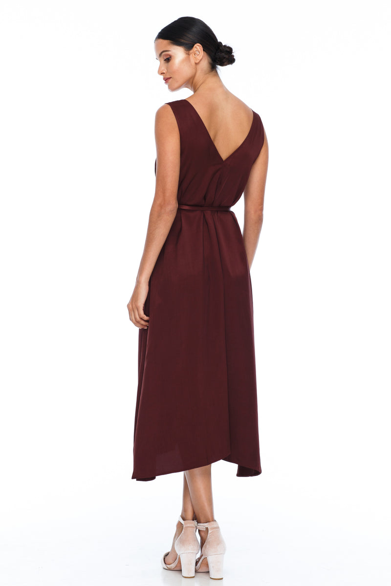 BLAK BRIDESMAIDS -  Calm Dress - Cinnamon - Featuring a low v-neckline front and back with wider straps. An easy fit dress with self-waist tie.  Midi Length / 100% viscose.