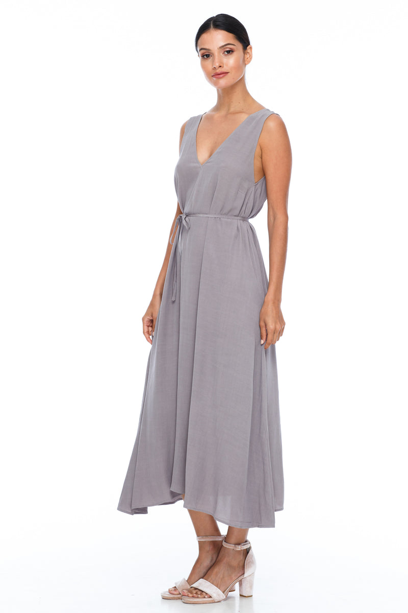 BLAK BRIDESMAIDS -  Calm Dress - Pewter - Featuring a low v-neckline front and back with wider straps. An easy fit dress with self-waist tie.  Midi Length / 100% viscose. Image shows front view.