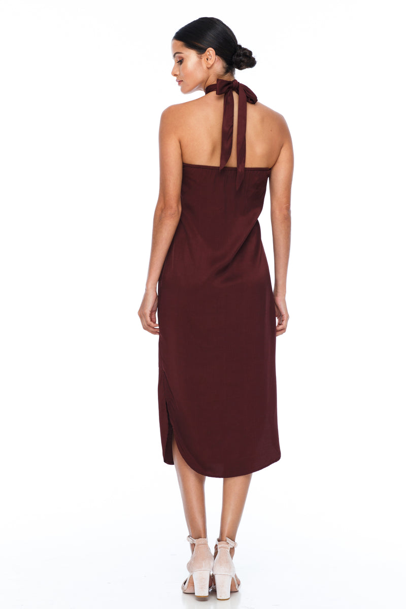 A BLAK BRIDESMAID Dress   A stunning sophisticated silhouette. Featuring a high neckline, slimline body shape, mid length with curved side seams to flatter the figure. This is the Bridesmaids dress for your    - Keyhole back detail - Comes with optional skinny waist tie - 100% Viscose - Cinnamon - Back View