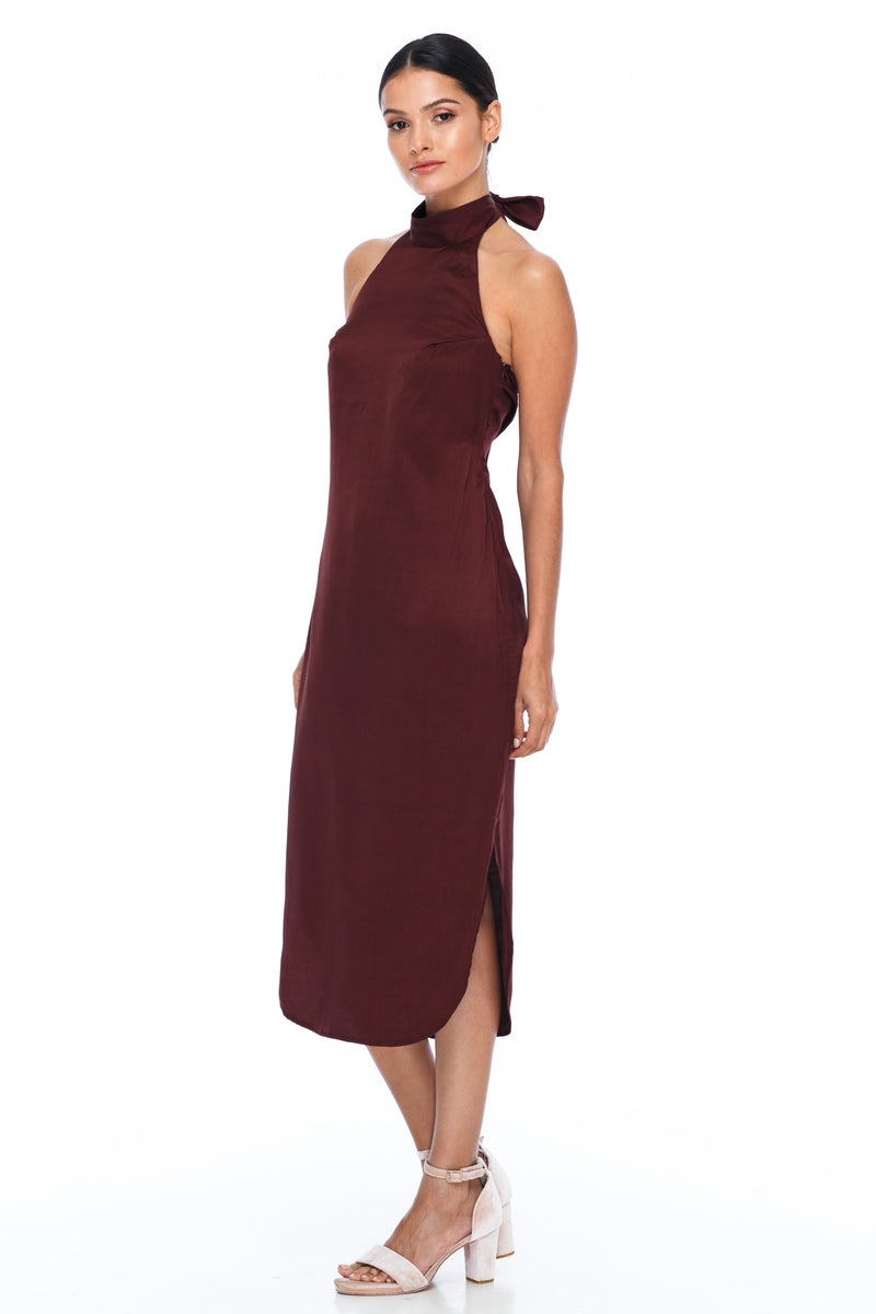 A BLAK BRIDESMAID Dress   A stunning sophisticated silhouette. Featuring a high neckline, slimline body shape, mid length with curved side seams to flatter the figure. This is the Bridesmaids dress for your    - Keyhole back detail - Comes with optional skinny waist tie - 100% Viscose - Cinnamon - Front Side View