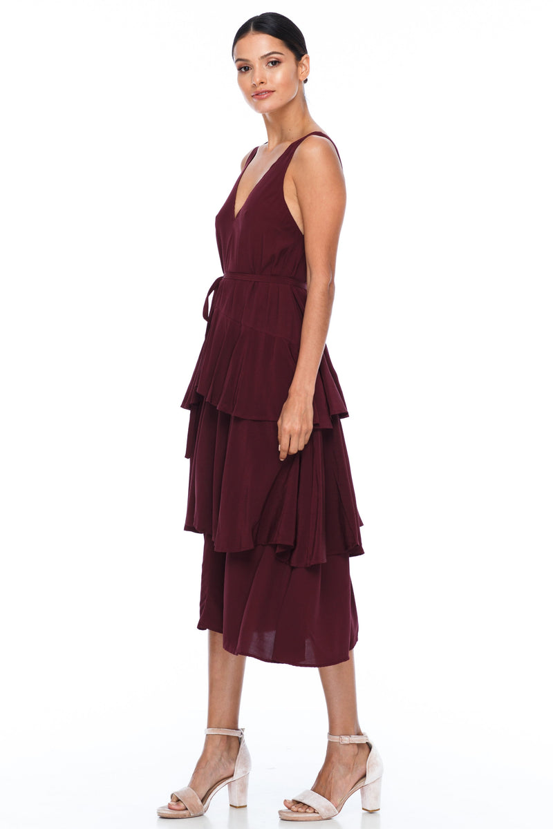 A Blak Bridesmaid Dress - The Frida - Cinnamon - A flowy layered skirt a low v-neckline front and back - Midi Length - Image shows side view