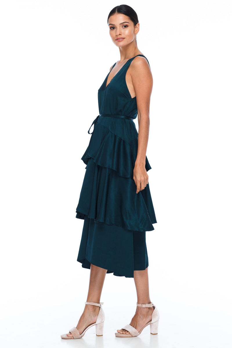 BLAK BRIDESMAIDS - Frida Dress - Emerald - A flowy layered skirt a low v-neckline front and back - Midi Length - Image shows side view