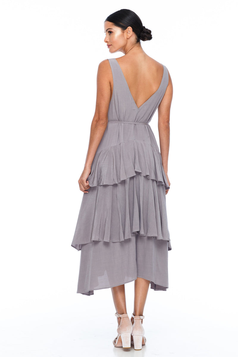 BLAK BRIDESMAIDS - Frida Dress - Colour - Pewter - A flowy layered skirt a low v-neckline front and back - Midi Length - Image shows back view
