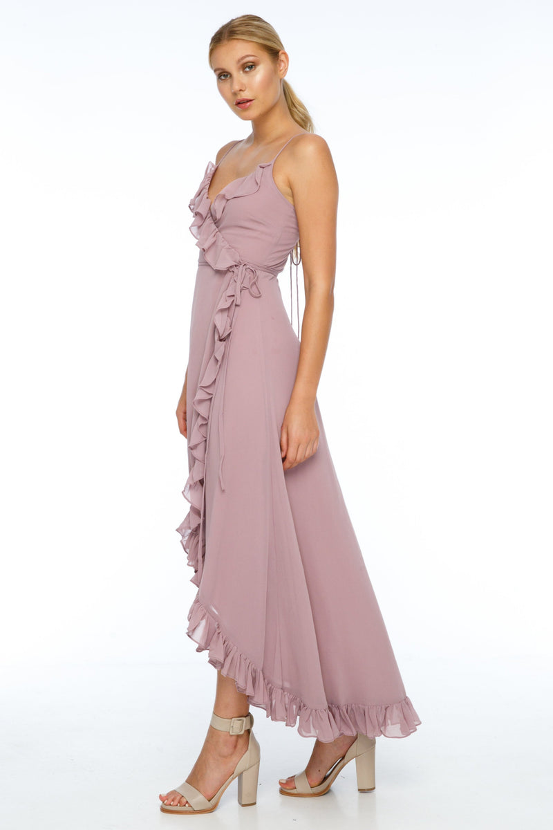 A beautiful wrap bridesmaid dress with stunning frill detailing all the way around for maximum impact in your wedding photos.  Dainty adjustable back strap/tie. Wrap Full length back, midi length front 100% viscose Being a wrap style is it the perfect dress for your bridesmaids who are overseas and can't make it in for a fitting - Side View