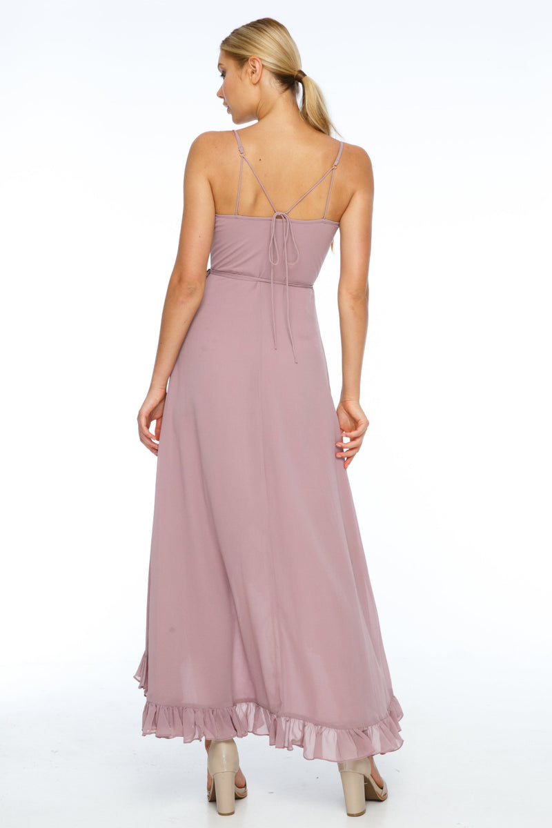 A beautiful wrap bridesmaid dress with stunning frill detailing all the way around for maximum impact in your wedding photos.  Dainty adjustable back strap/tie. Wrap Full length back, midi length front 100% viscose Being a wrap style is it the perfect dress for your bridesmaids who are overseas and can't make it in for a fitting - Back View