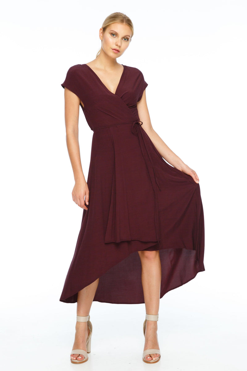 BLAK BRIDESMAIDS  Beautifully crafted with a free flowing style, an asymmetrical hemline with a shorter front, cut in a circular shape creating length at the back; The Eternal Dress is a flattering and chic cut. With a wrap-around waist tie and short sleeves, this V-neckline dress is a popular style for all shapes - Front View