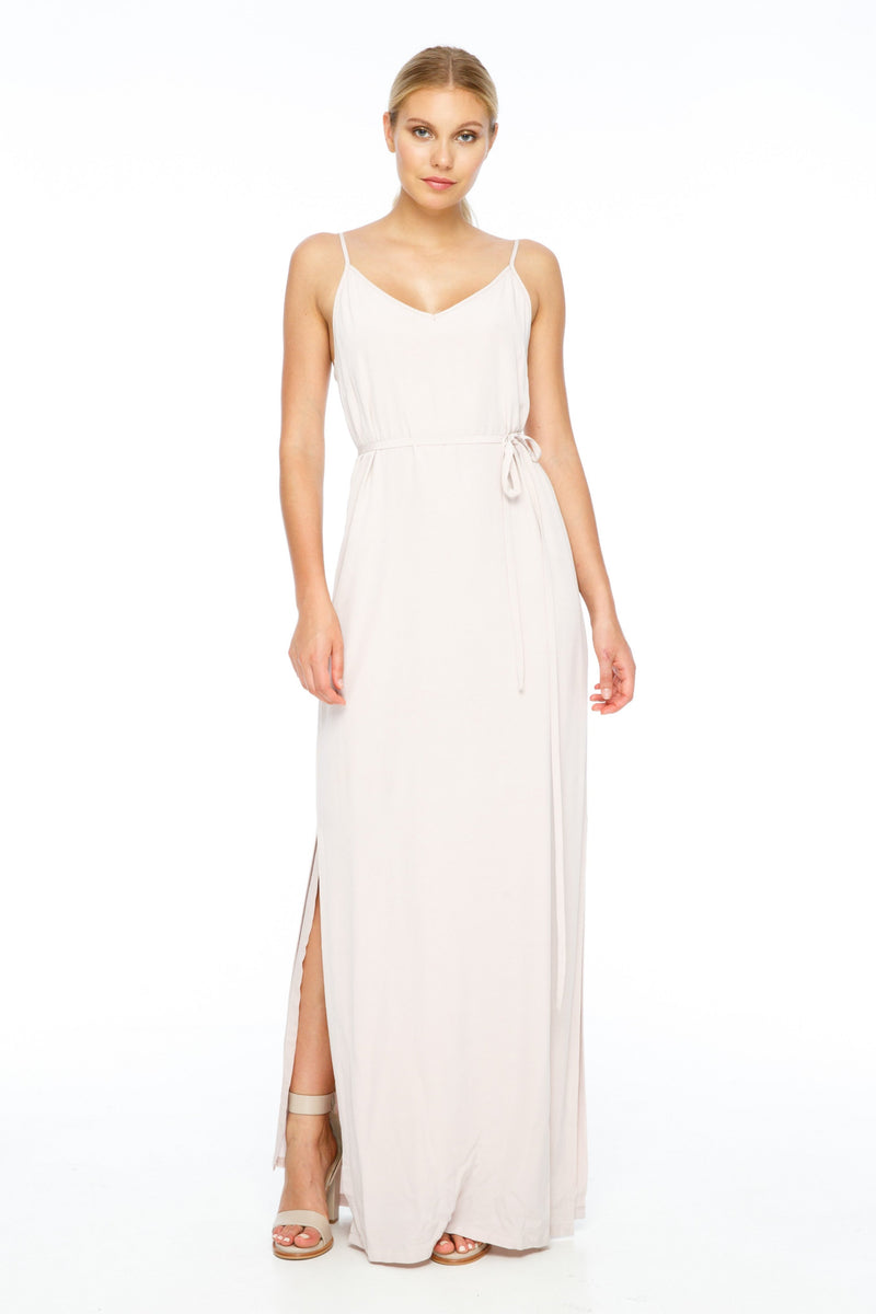 BLAK BRIDESMAIDS  A minimal yet classic dress that is free flowing. Strap detail on the back and side splits for a modern twist. You can also style with a thin or thick waist string for a more fitted look (both options come with the dress). Front view