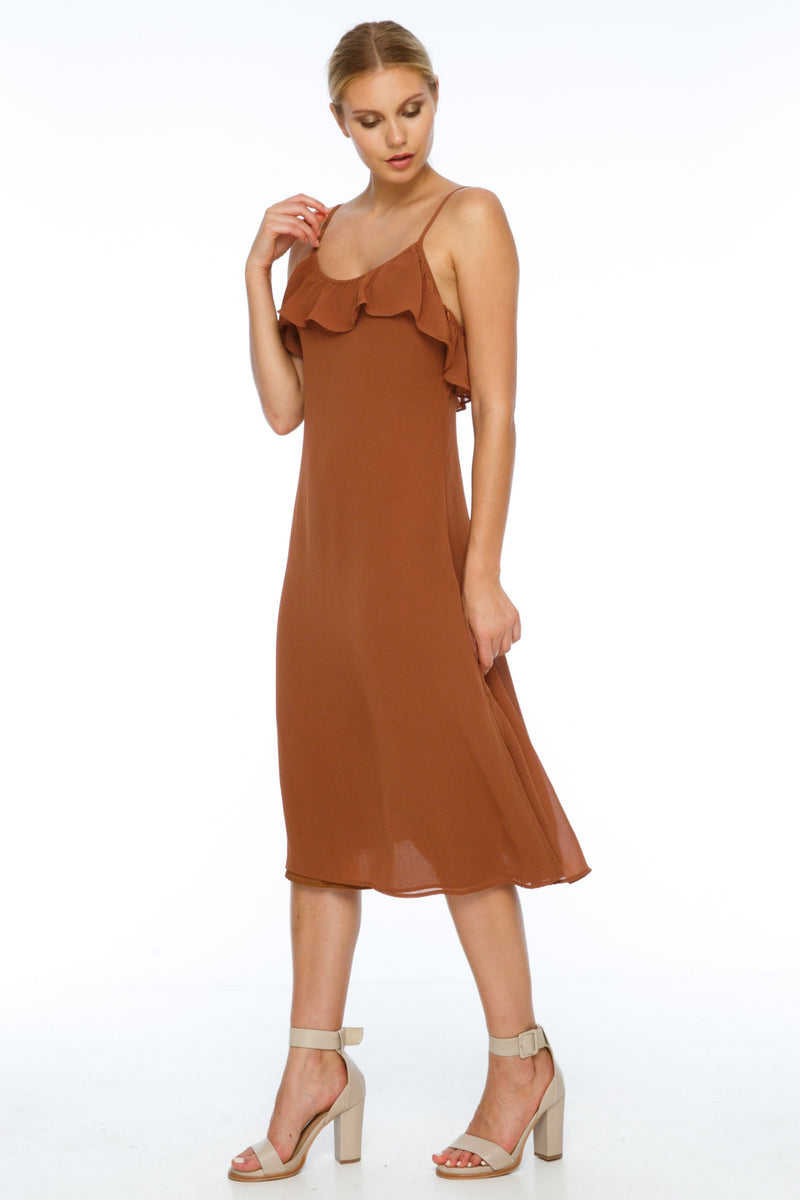 BLAK BRIDESMAIDS  A simple slip dress with a straight cut, the Eden Dress is a classic easy shape. With romantic ruffle detail along the neckline and slight side splits, it is both feminine yet effortless. Adjustable shoulder straps add to the versatility of the dress. Front View.